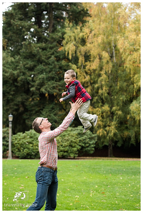 Dad tossing son in the air
